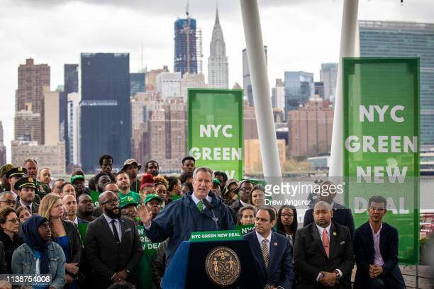 New York City Mayor Bill de Blasio speaks about the city's strategy to respond to climate change at Hunters Point South Park April 22 2019 in the...