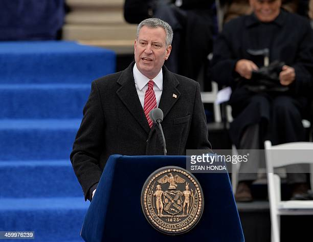 New York City Mayor Bill de Blasio speaks after being sworn in on the steps of City Hall in Lower Manhattan January 1 2014 in New York AFP PHOTO/Stan...