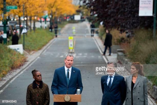 New York City Mayor Bill de Blasio speaks as his wife Chirlane McCray Argentinas Presidnet Mauricio Macri and Frist Lady Juliana Awada listen during...