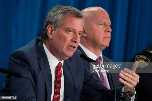 NYPD Chief of Patrol Rodney Harrison New York City Police Commissioner James O'Neill and New York City Mayor Bill de Blasio depart a news conference...