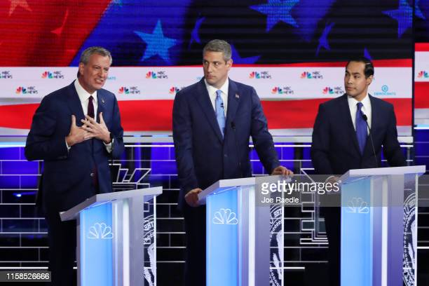 New York City Mayor Bill De Blasio speaks as Rep Tim Ryan and former housing secretary Julian Castro look on during the first night of the Democratic...