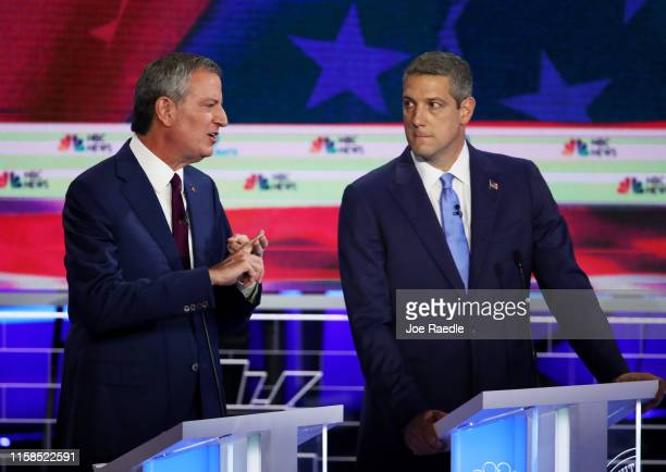 New York City Mayor Bill De Blasio speaks as Rep. Tim Ryan looks on during the first night of the Democratic presidential debate on June 26, 2019 in...