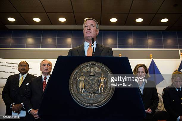 New York City Mayor Bill de Blasio speaks at a press conference after witnessing police being retrained with new guidelines at the Police Academy on...