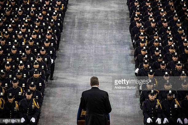 New York City Mayor Bill De Blasio speaks at the 2014 graduation ceremony for the New York Police Department on June 30 2014 at Madison Square Garden...