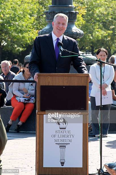 New York City mayor Bill de Blasio speaks during the Statue of Liberty Museum unveiling and groundbreaking ceremony at Liberty Island on October 6...