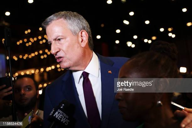New York City Mayor Bill De Blasio speaks to the media in the spin room following the first night of the Democratic presidential debate on June 26...