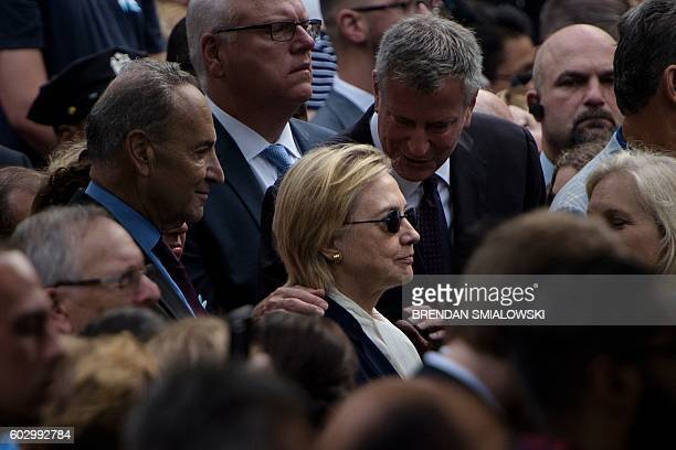 TOPSHOT New York City Mayor Bill de Blasio speaks to US Democratic presidential nominee Hillary Clinton during a memorial service at the National...