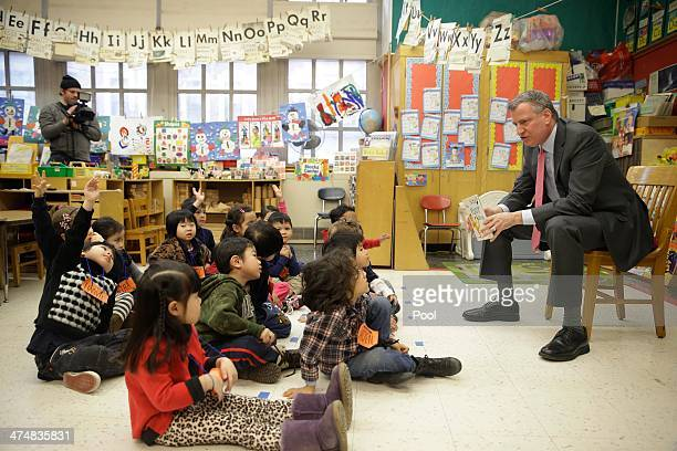 New York City Mayor Bill de Blasio talks with children after reading them a book in a prekindergarten class at PS 130 on February 25 2014 in New York...