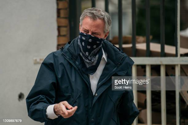New York City Mayor Bill de Blasio wears a bandana over his face while speaking at a food shelf organized by The Campaign Against Hunger in Bed Stuy...