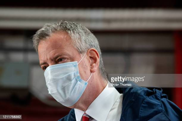 New York City Mayor Bill DeBlasio speaks to firefighters following the donation of meals on International Firefighters Day on May 4 2020 in New York...