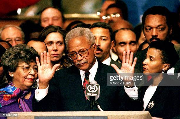 New York City Mayor David Dinkins quiets the crowd of supporters 03 November 1993 during his concession speech Mayor Dinkins lost the election for...