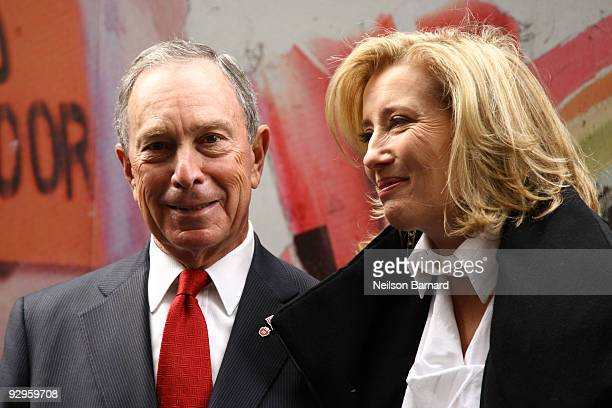 New York City Mayor Michael Bloomberg and Actress Emma Thompson attend the Journey exhibition opening at Washington Square Park on November 10 2009...