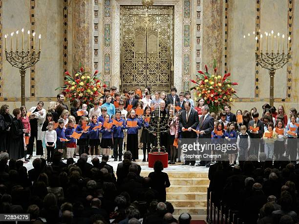 New York City Mayor Michael Bloomberg and New York Governorelect Eliot Spitzer are joined by children of the congregation for the lighting of the...