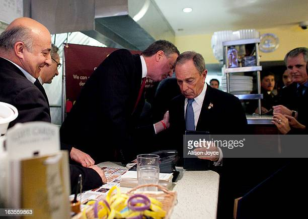 New York City Mayor Michael Bloomberg attends a press conference about the health impacts of sugar at Lucky's restaurant which voluntarily adopted...