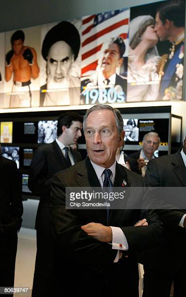 New York City Mayor Michael Bloomberg gets a tour of the exhibit his company during the grand opening of the Newseum April 11, 2008 in Washington,...
