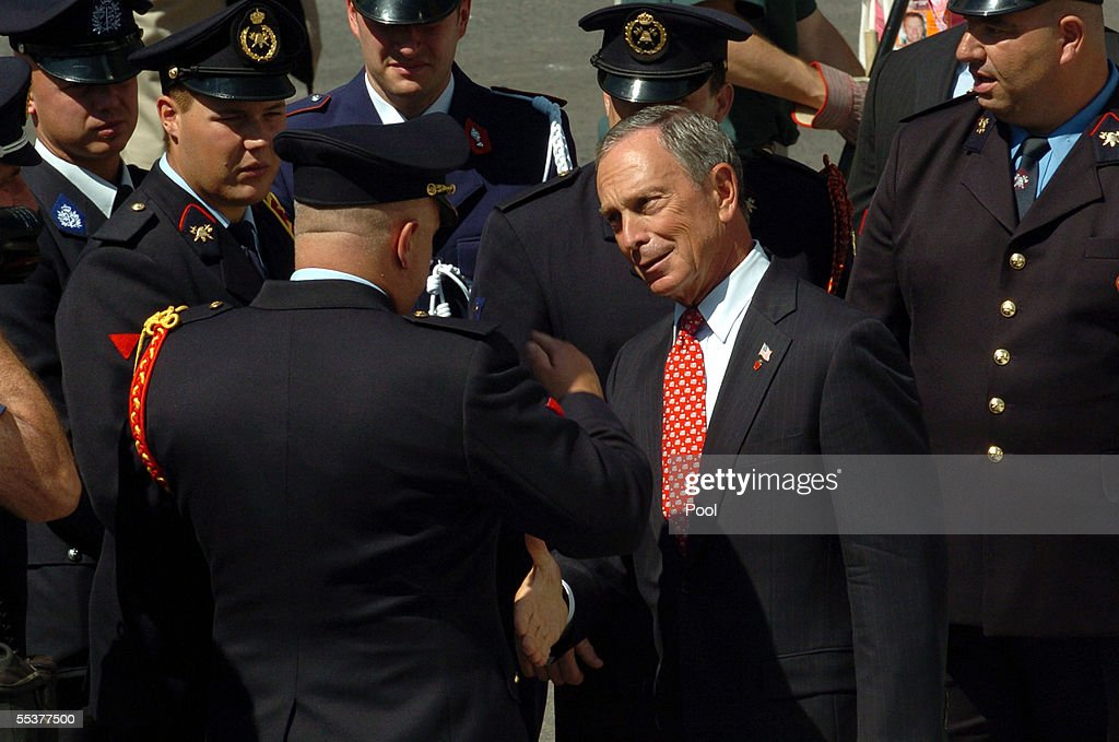 New York City Mayor Michael Bloomberg (Center-R) greets Belgian firemen at a 9/11 commemoration ceremony September 11, 2005 in New York City. This is the fourth anniversary commemoration of the September 11, 2001 attacks.