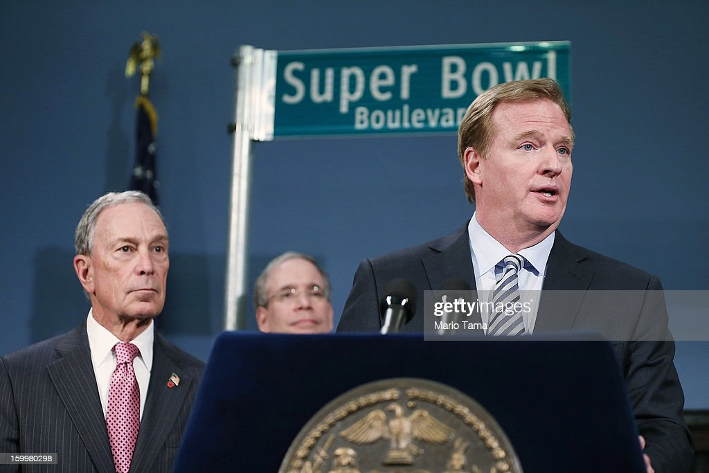 New York City Mayor Michael Bloomberg (L) looks on as National Football League (NFL) Commissioner Roger Goodell (R) speaks at a City Hall press conference announcing plans for Super Bowl XLVIII in the region on January 24, 2012 in New York City. The New York/New Jersey region's first Super Bowl will see the creation of a 'Super Bowl Boulevard' fan attraction along Broadway in midtown Manhattan.