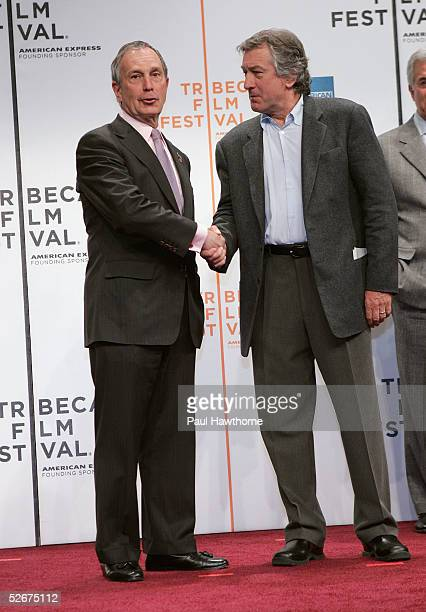 New York City Mayor Michael Bloomberg shakes hands with actor Robert De Niro at the opening press conference to kick off the 4th Annual Tribeca Film...