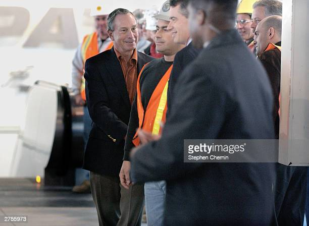 New York City Mayor Michael Bloomberg shakes hands with PATH workers as he enters the World Trade Center PATH Station November 23 2003 in New York...