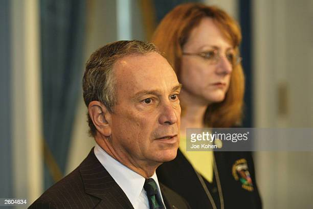 New York City Mayor Michael Bloomberg speaks as National Transportation Safety Board Chairwoman Ellen Englemen listens during a media conference at...