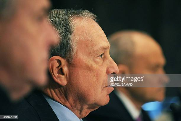 New York City Mayor Michael Bloomberg speaks as New York City Police Commissioner Raymond Kelly and Rep Peter King RNY listen during a hearing on...