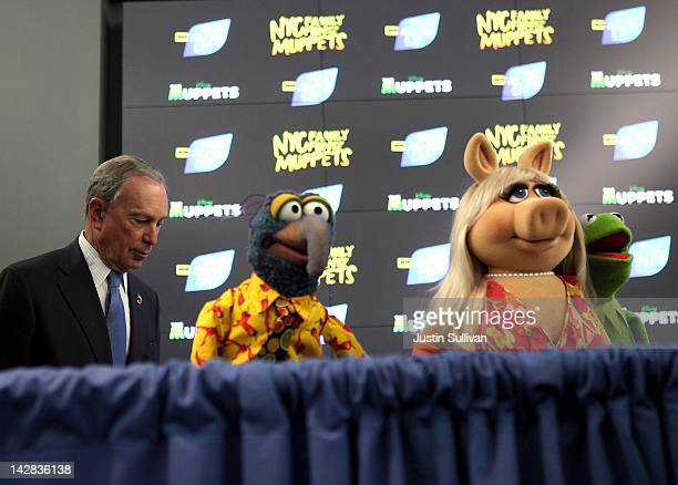 New York City Mayor Michael Bloomberg stands with Muppets Gonzo Miss Piggy and Kermit the Frog during a news conference on April 13 2012 in New York...