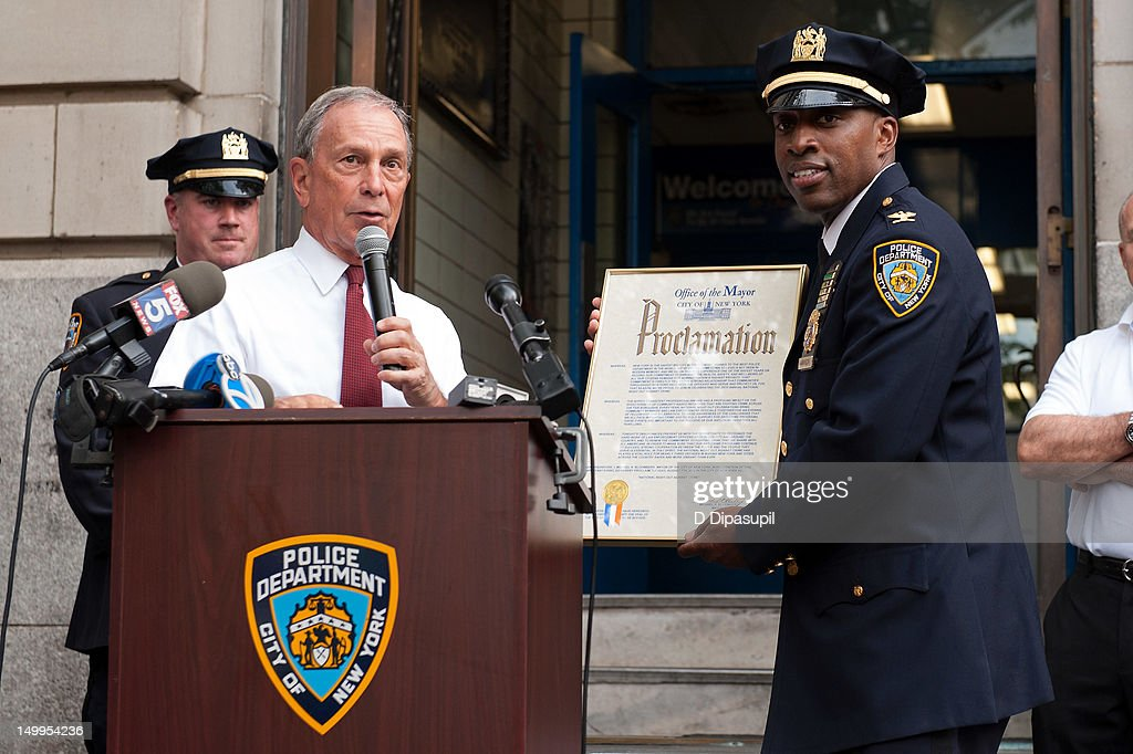 New York City mayor Michael R. Bloomberg (2nd L) and New York Police Department Inspector Rodney Harrison (R) attend National Night Out on the streets of Manhattan on August 7, 2012 in New York City.