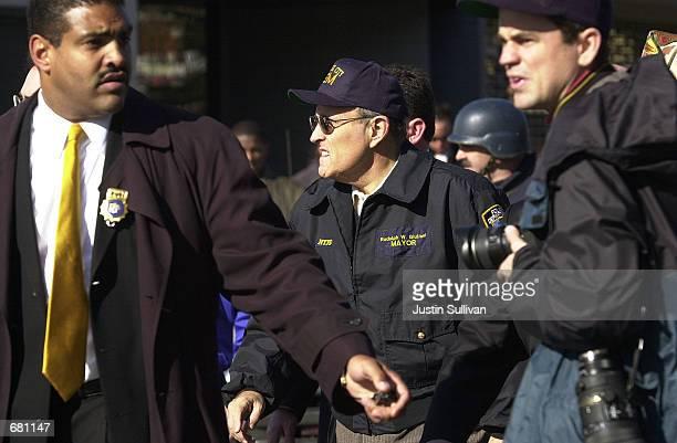 New York City Mayor Rudolph Giuliani arrives at the scene where American Airlines Flight 587 crashed November 12, 2001 in Rockaway Beach, New York...