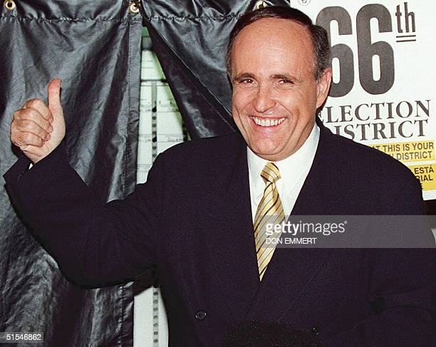 New York City Mayor Rudolph Giuliani gives a thumbs up after exiting a voting booth 04 November 1997 in New York after voting in the 1997 New York...