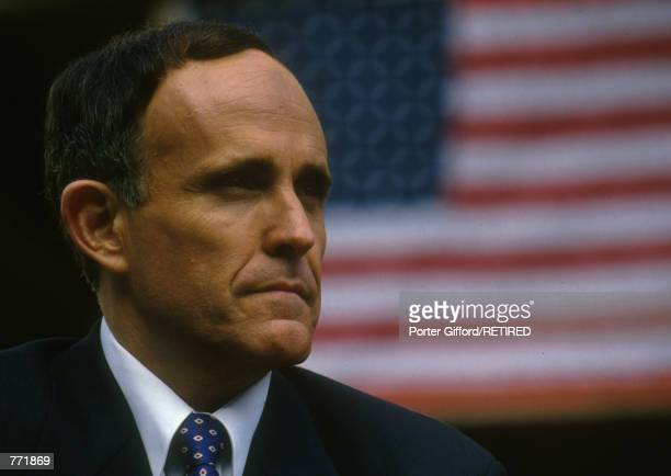 New York City Mayor Rudolph Giuliani poses in front of an American flag February 1, 1994. Giuliani announced at a press conference April 27, 2000...
