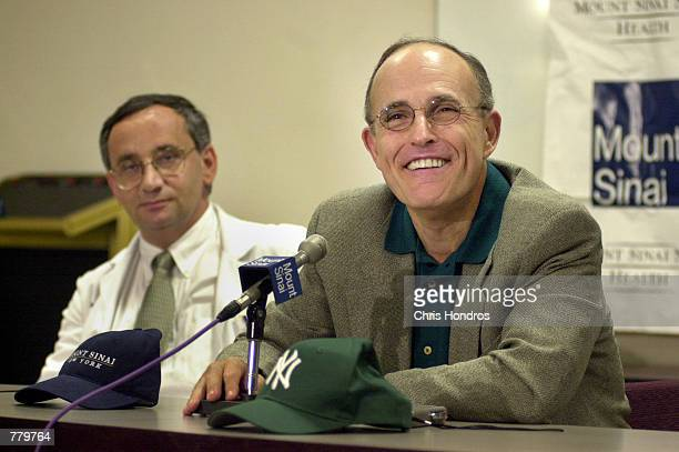 New York City Mayor Rudolph Giuliani right talks with reporters September 15 2000 at Mt Sinai hospital in New York City Mayor Giuliani underwent...