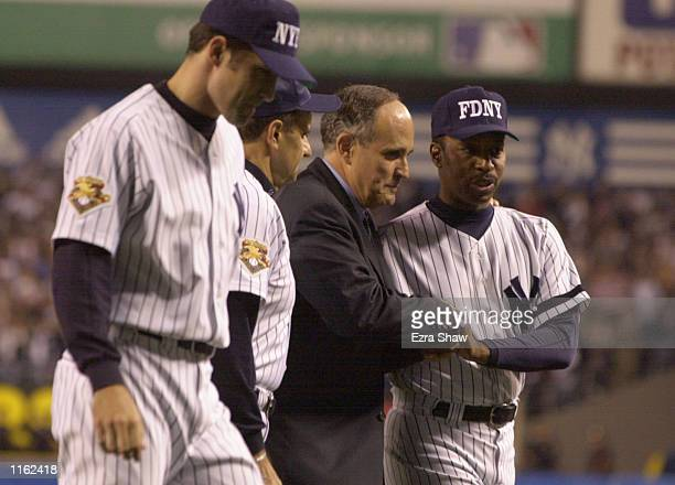 New York City Mayor Rudolph Giuliani shakes hands with Willie Randolph of the New York Yankees before the Yankees game against the Tampa Bay Devil...