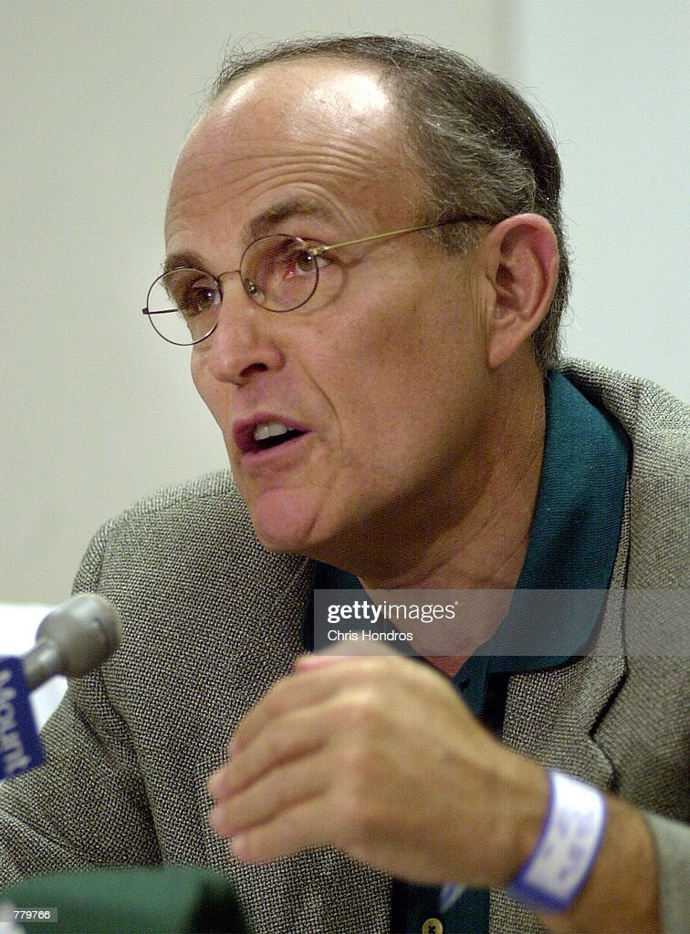 New York City Mayor Rudolph Giuliani, right, talks with reporters after surgery : News Photo
