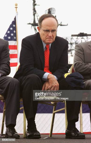 New York City Mayor Rudoph Giuliani sits during Memorial Day commemoration on the US naval museum USS Intrepid on the Hudson River in New York The US...