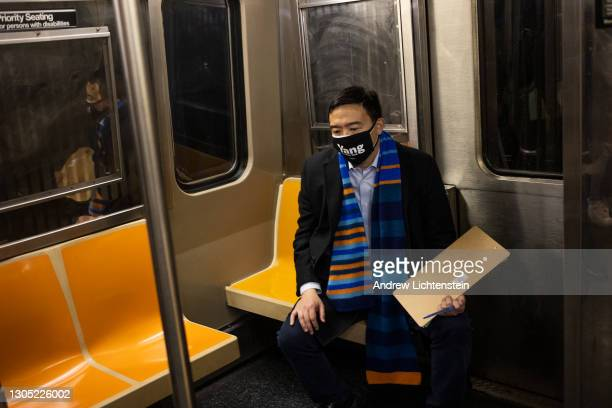 New York City mayoral candidate Andrew Yang collects signatures to be on the Democratic primary ballot as he campaigns for mayor, March 3, 2021 on...