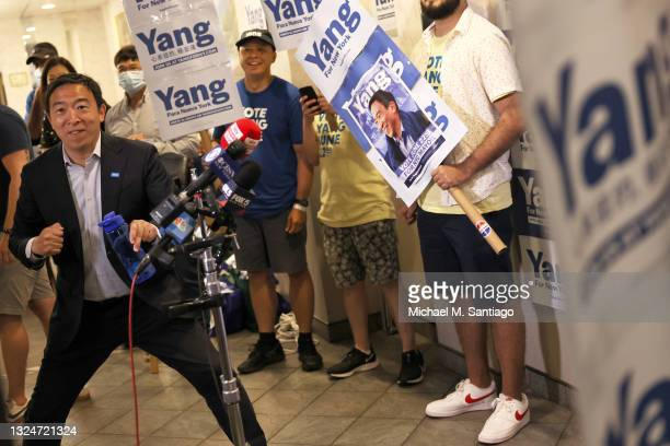 New York City mayoral candidate Andrew Yang dances as he arrives at a press conference with Assembly Member Simcha Eichenstein on June 21, 2021 in...