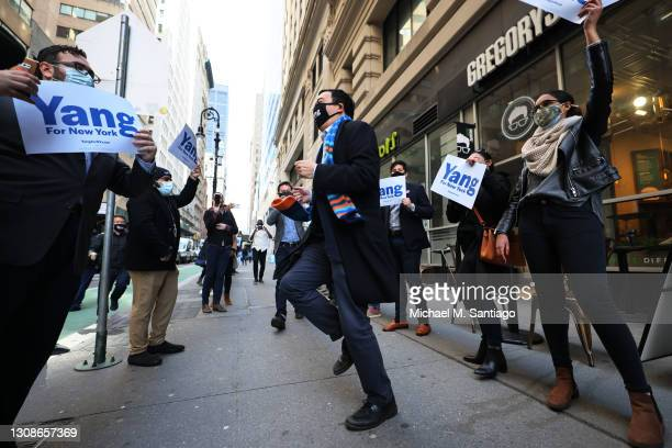 New York City mayoral candidate Andrew Yang dances as he arrives atthe NYC Board of Elections office on March 23, 2021 in New York City. Yang dropped...