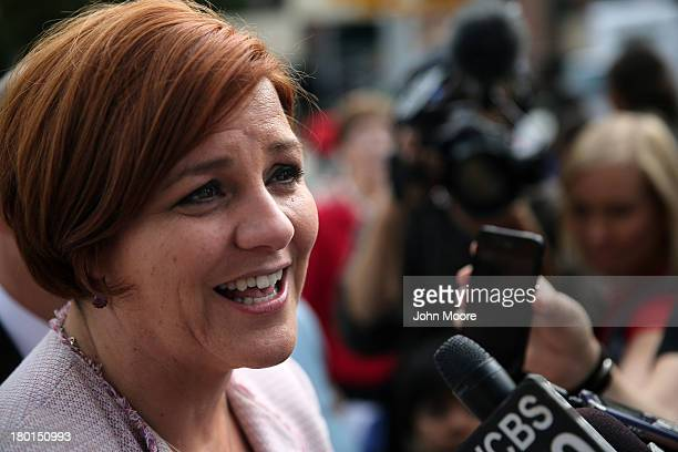 New York City mayoral candidate Christine Quinn talks with the media outside a school on September 9 2013 in the Queens borough of New York City...