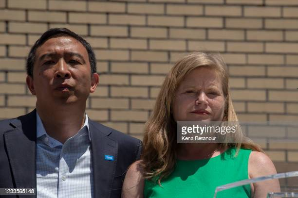 New York City mayoral candidates Andrew Yang and Kathryn Garcia attend the unveiling of a mural in Chinatown on June 20, 2021 in New York City. Yang...