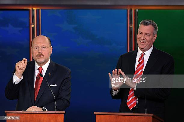 New York City mayoral candidates Joe Lhota and Bill de Blasio participate in a debate on October 30 2013 in New York City This is the final debate...
