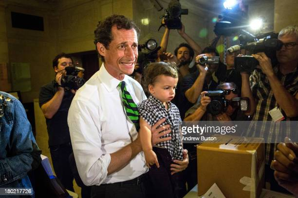 New York City mayoral hopeful Anthony Weiner arrives at his polling station with his son Jordan Weiner to vote in the Democratic primary on September...