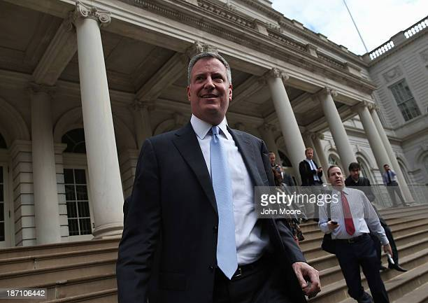 New York City Mayorelect Bill de Blasio leaves City Hall after meeting with outgoing Mayor Michael Bloomberg on November 6 2013 in New York City It...