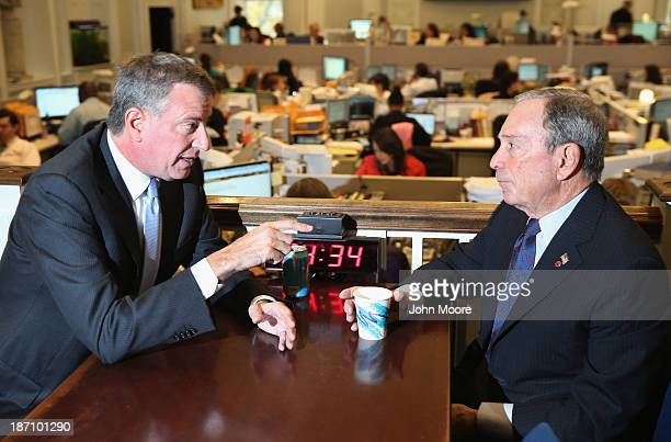 New York City Mayorelect Bill de Blasio speaks with outgoing Mayor Michael Bloomberg at City Hall on November 6 2013 in New York City It was the...