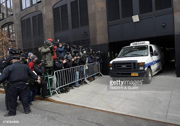 A New York City Medical Examiner van drives out of a garage with the body of fashion designer L'Wren Scott the girlfriend of Rolling Stones frontman...