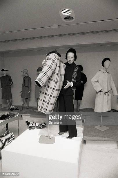New York City: Metropolitan Museum. Diana Vreeland shows off a one seam coat by Balenciaga. Photograph, 3/22/73.