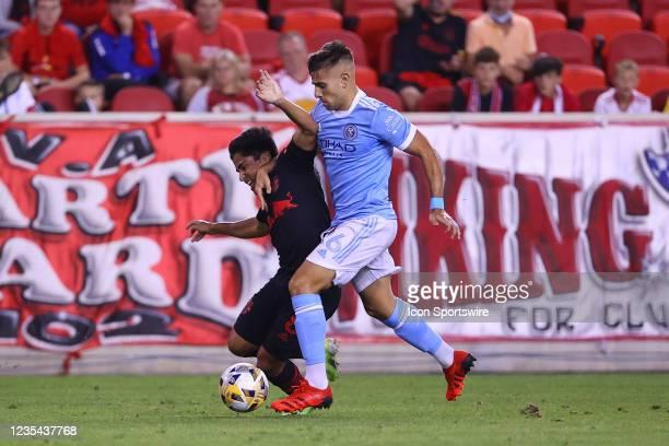New York City midfielder Nicolas Acevedo battles New York Red Bulls midfielder Frankie Amaya during the second half of the Major League Soccer game...