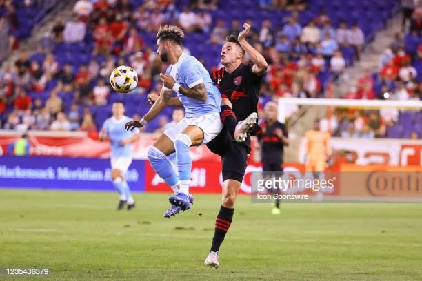 New York City midfielder Valentin Castellanos battles New York Red Bulls defender Sean Nealis during the first half of the Major League Soccer game...