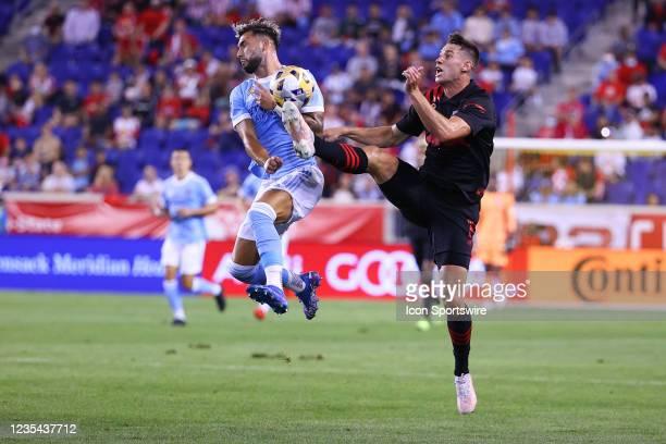New York City midfielder Valentin Castellanos battles New York Red Bulls defender Sean Nealis during the Major League Soccer game between the New...