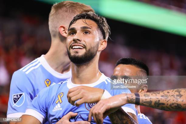 New York City midfielder Valentin Castellanos celebrates after he scores during the first half of the Major League Soccer game between the New York...