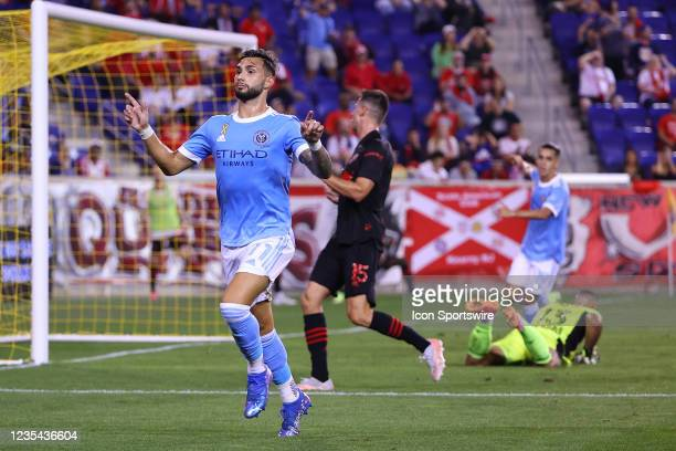 New York City midfielder Valentin Castellanos celebrates after he scores past New York Red Bulls goalkeeper Carlos Miguel Coronel during the first...